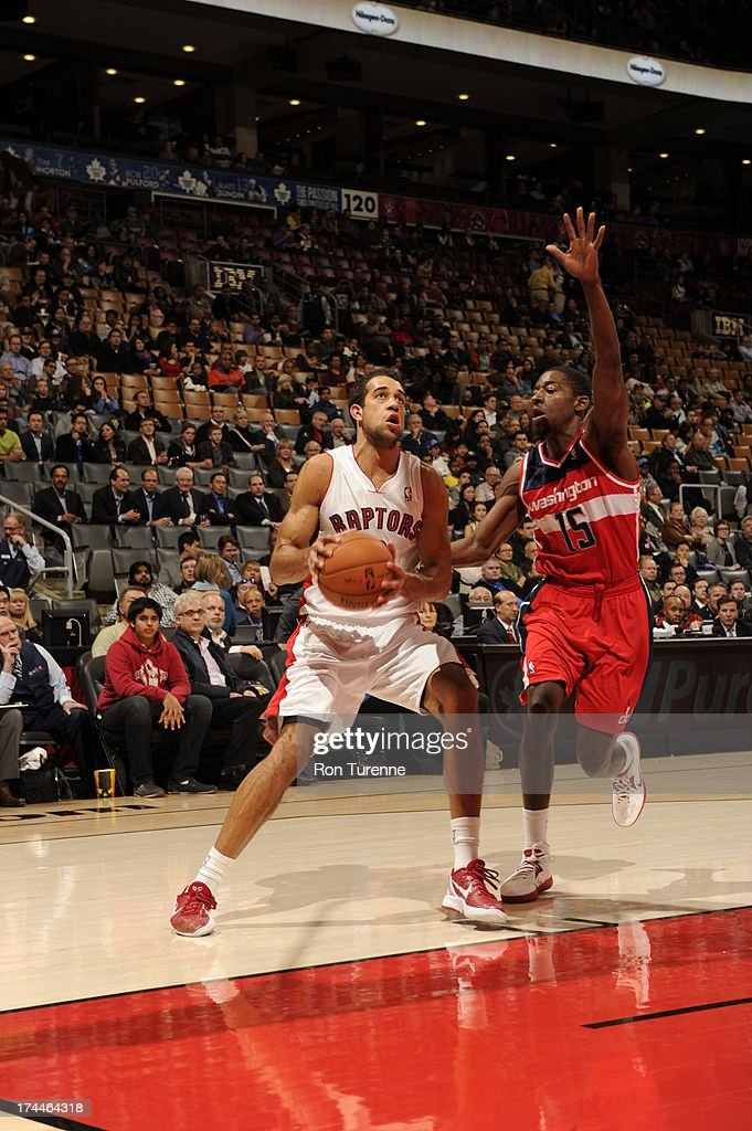 <a gi-track='captionPersonalityLinkClicked' href=/galleries/search?phrase=Landry+Fields&family=editorial&specificpeople=4184645 ng-click='$event.stopPropagation()'>Landry Fields</a> #2 of the Toronto Raptors looks to shoot against <a gi-track='captionPersonalityLinkClicked' href=/galleries/search?phrase=Jordan+Crawford&family=editorial&specificpeople=4779380 ng-click='$event.stopPropagation()'>Jordan Crawford</a> #15 of the Washington Wizards during a pre-season game on October 17, 2012 at the Air Canada Centre in Toronto, Ontario, Canada.
