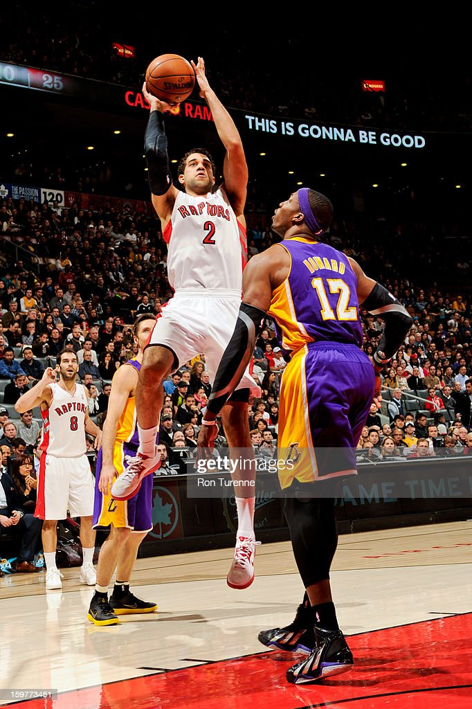 Landry Fields #2 of the Toronto Raptors shoots against Dwight Howard #12 of the Los Angeles Lakers on January 20, 2013 at the Air Canada Centre in Toronto, Ontario, Canada.