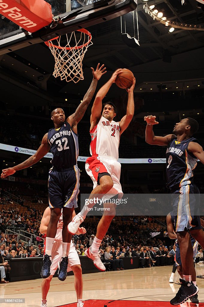 <a gi-track='captionPersonalityLinkClicked' href=/galleries/search?phrase=Landry+Fields&family=editorial&specificpeople=4184645 ng-click='$event.stopPropagation()'>Landry Fields</a> #2 of the Toronto Raptors shoots the ball against Ed Davis #32 and <a gi-track='captionPersonalityLinkClicked' href=/galleries/search?phrase=Tony+Allen+-+Basketball+Player&family=editorial&specificpeople=201665 ng-click='$event.stopPropagation()'>Tony Allen</a> #9 of the Memphis Grizzlies during the game on October 23, 2013 at the Air Canada Centre in Toronto, Ontario, Canada.