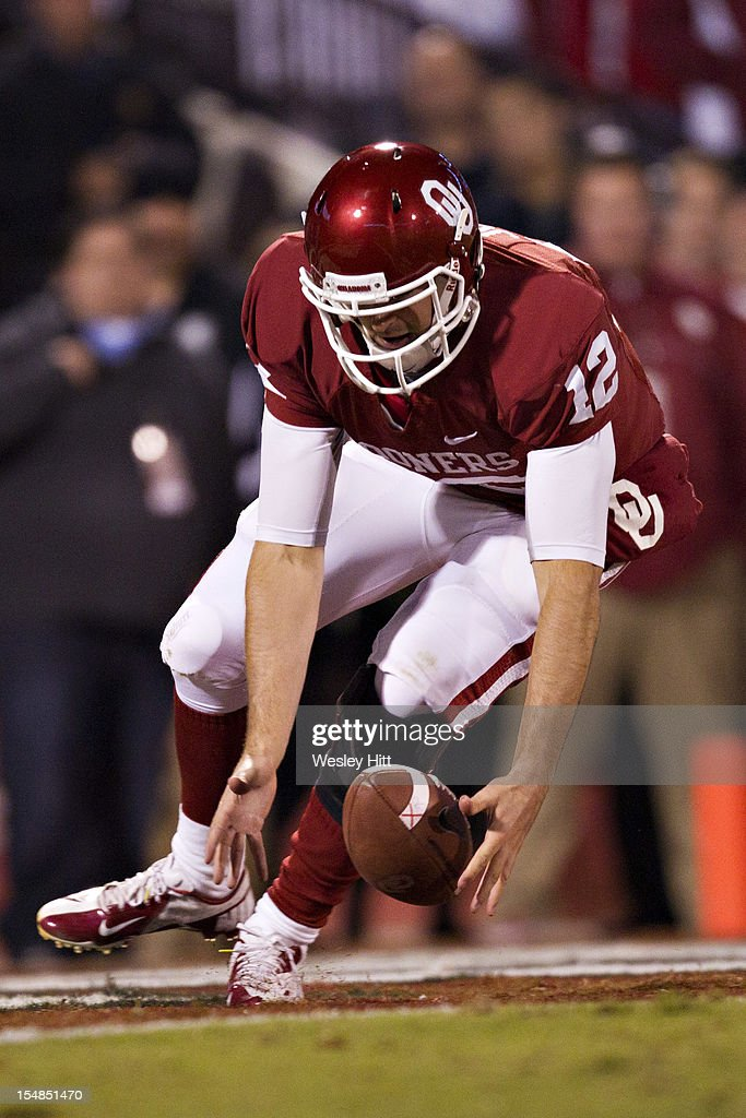 <a gi-track='captionPersonalityLinkClicked' href=/galleries/search?phrase=Landry+Jones&family=editorial&specificpeople=5572476 ng-click='$event.stopPropagation()'>Landry Jones</a> #12 of the Oklahoma Sooners picks up a fumbled snap in the end zone during a game against the Notre Dame Fighting Irish at Gaylord Family Oklahoma Memorial Stadium on October 27, 2012 in Norman, Oklahoma. The Fighting Irish defeated the Sooners 30-13.