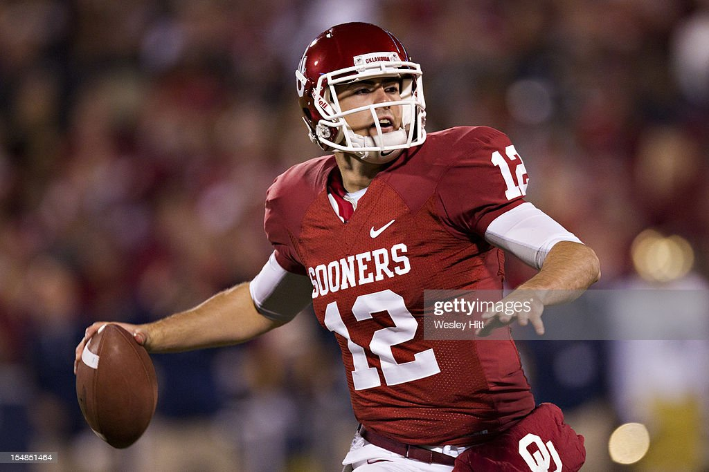 <a gi-track='captionPersonalityLinkClicked' href=/galleries/search?phrase=Landry+Jones&family=editorial&specificpeople=5572476 ng-click='$event.stopPropagation()'>Landry Jones</a> #12 of the Oklahoma Sooners throws a pass against the Notre Dame Fighting Irish at Gaylord Family Oklahoma Memorial Stadium on October 27, 2012 in Norman, Oklahoma. The Fighting Irish defeated the Sooners 30-13.