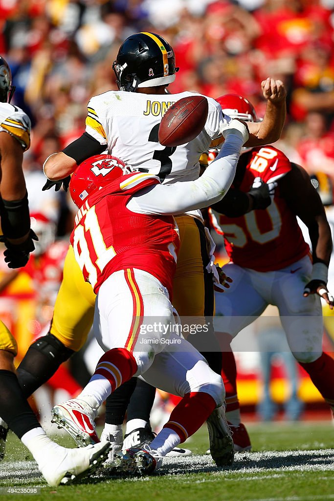 <a gi-track='captionPersonalityLinkClicked' href=/galleries/search?phrase=Landry+Jones&family=editorial&specificpeople=5572476 ng-click='$event.stopPropagation()'>Landry Jones</a> #3 of the Pittsburgh Steelers is fumbles the ball after a sack by <a gi-track='captionPersonalityLinkClicked' href=/galleries/search?phrase=Tamba+Hali&family=editorial&specificpeople=630576 ng-click='$event.stopPropagation()'>Tamba Hali</a> #91 of the Kansas City Chiefs at Arrowhead Stadium during the fourth quarter of the game on October 25, 2015 in Kansas City, Missouri.