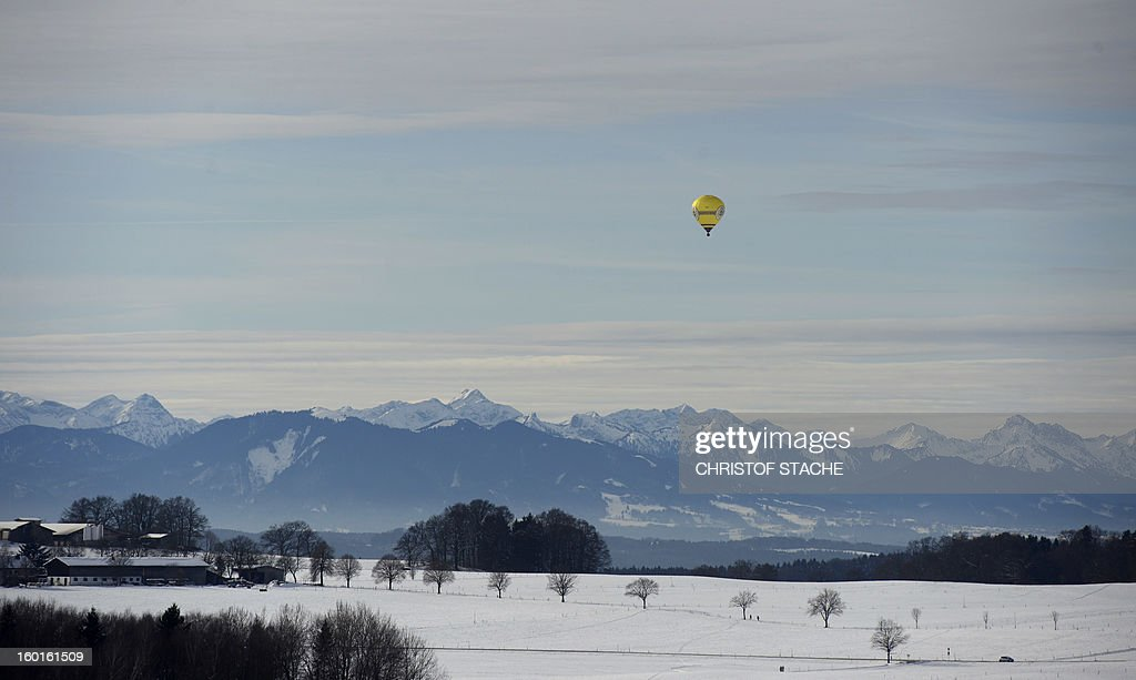 Landscape and the Alps panorama near Muensing, southern Germany, are covered in snow on January 27, 2013. Meteorologists forecast milder weather with temperatures climbing above the freezing point for many parts of the country. AFP PHOTO / CHRISTOF STACHE