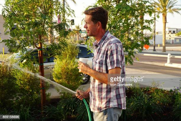 Landscape Architect Jay Pleggenkuhle waters one of the 58 trees planted in remembrance of the victims of the recent Las Vegas mass shooting on...