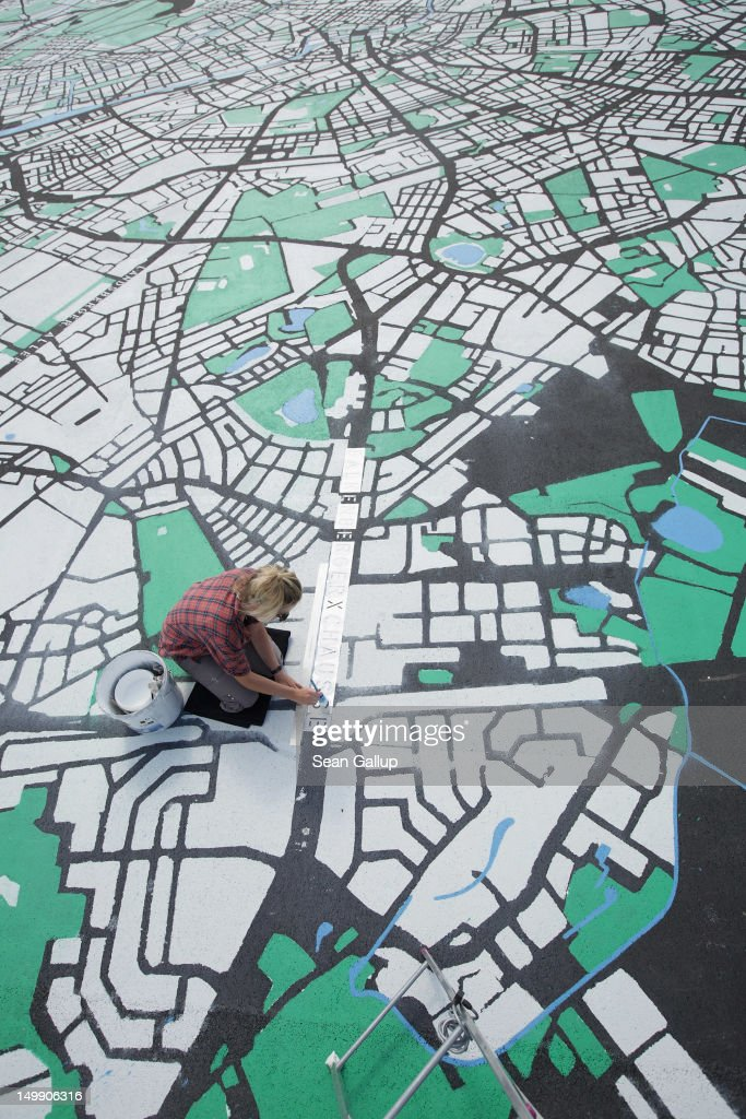 Landscape architect Lisa Hankow paints a giant map of Berlin in the city center on August 6, 2012 in Berlin, Germany. The map, which will measure 50 meters X 50 meters when finished, is in the scale of 1:775 and is an art installation meant to coincide with 775th anniversary of Berlin, which the city will celebrate in October.