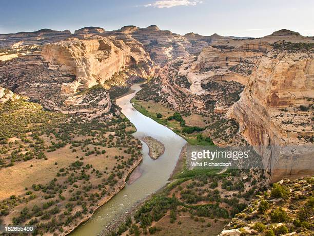 A landscape image of a river running through a canyon.