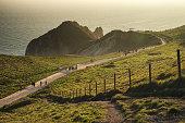 Landscape sunset image of Durdle Door on Jurassic Coast in Dorset during Spring sunset