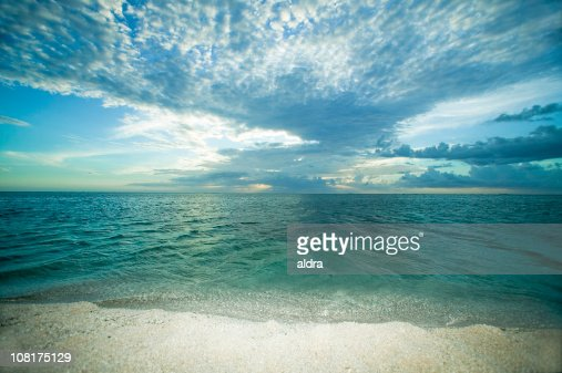 Landscape of Beach and Water's Edge with Clouds in Sky : Stock Photo