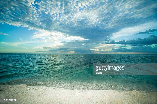 Landscape of Beach and Water's Edge with Clouds in Sky