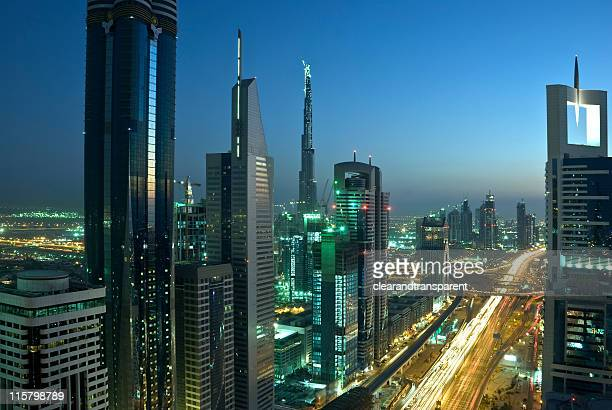 Landscape of Dubai skyscrapers and roads at night