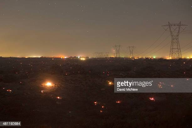 A landscape of embers burns in the wake of the North Fire which caused people to abandon their vehicles and flee as flames jumped the 215 freeway in...