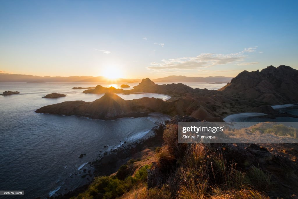 Landscape of Padar Island during sunset with dramatic sky in the Komodo National Park, East Nusa Tenggara, Labuan Bajo, Indonesia : Stock Photo