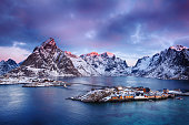 Beautiful sunrise landscape of picturesque fishing village in the mountains of Lofoten islands in Norwegian Sea, Norway