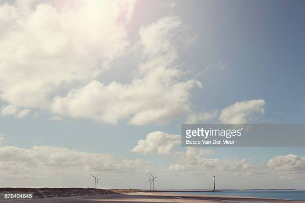 Landscape of the beach with wind turbines