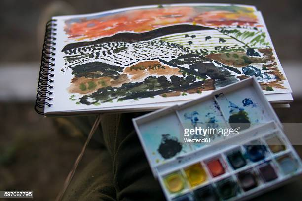 Landscape painting and paintbox