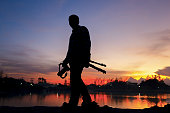 Landscape Photography concepts, silhouette of Professional photographer