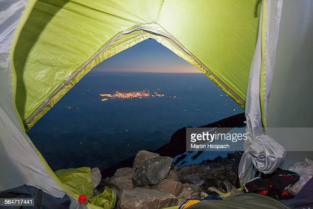 Landscape seen through tent on mountain at dusk