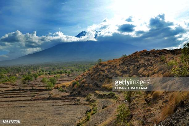 A landscape shaped by Mount Agung's past lava flows during ancient times are seen as the volcano looms in the background from the Kubu subdistrict of...