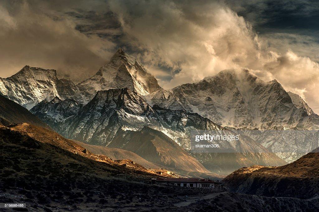 landscape sunset and dramatic lighting of kangtega peak  pheriche Solukhumbu