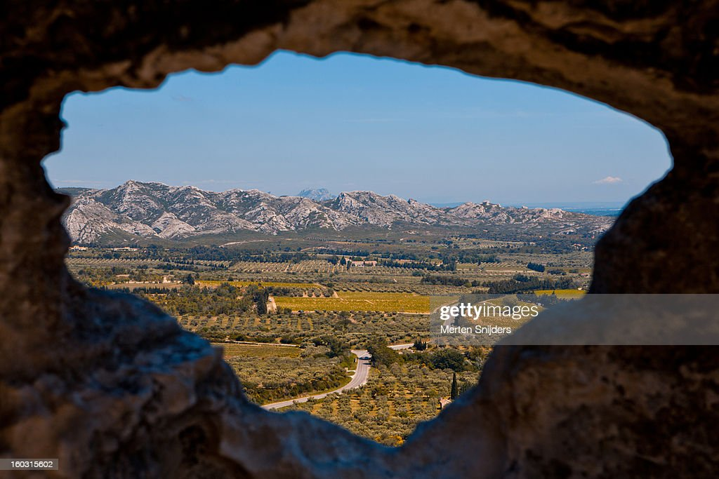 Landscape through hole in rock wall : Stock Photo