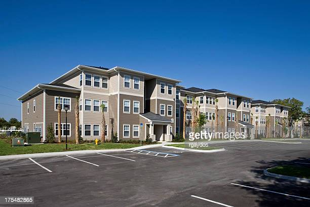 A landscape view of the exterior of a new apartment complex