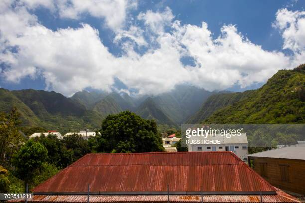 Landscape view of tin roof, village and mountains, Reunion Island