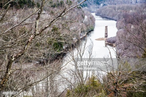 Landscape with a destroyed bridge : Stock Photo
