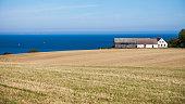 Baltic sea, Bornholm island. Beautiful landscape with sea, field and house