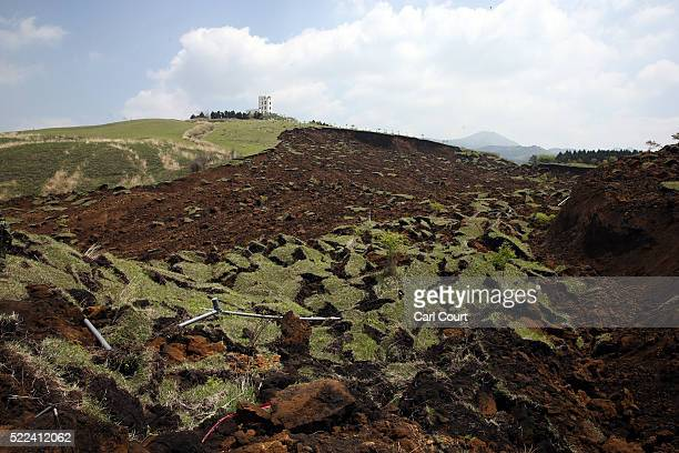 A landslide splits the side of a hill following an earthquake on April 19 2016 in Minamiaso near Kumamoto Japan As of April 19 45 people were...