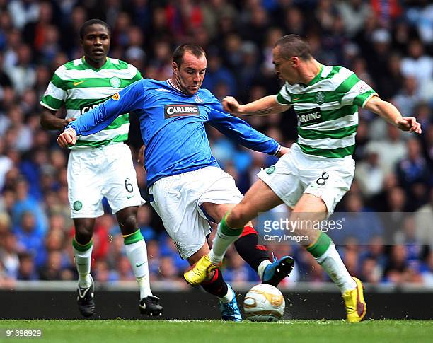 Landy N'Guemo of Celtic Kris Boyd of Rangers and Scott Brown of Celtic in action during the Clydesdale Bank Scottish Premier League match between...
