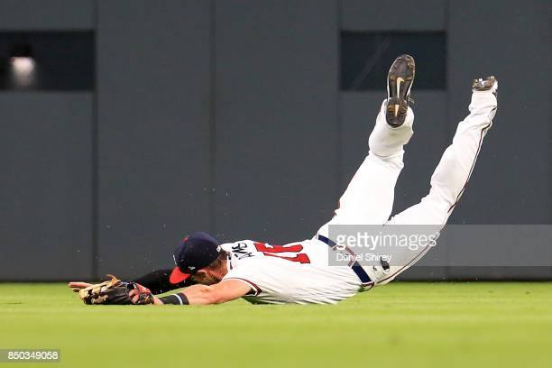 Lane Adams of the Atlanta Braves makes a diving catch during the third inning against the Washington Nationals at SunTrust Park on September 20 2017...