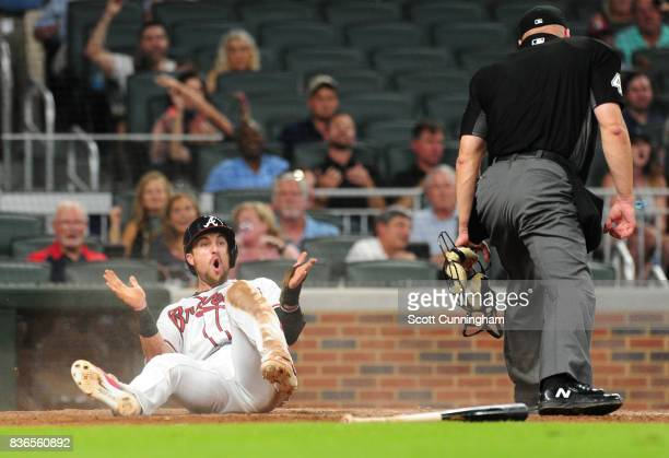Lane Adams of the Atlanta Braves reacts after being tagged out at home to end the sixth inning against the Seattle Mariners at SunTrust Park on...