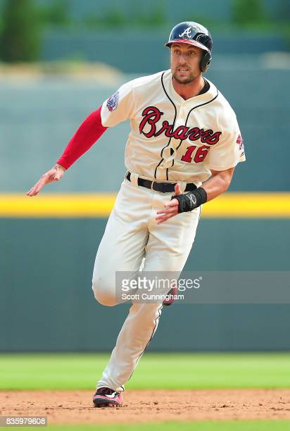 Lane Adams of the Atlanta Braves rounds seond base during the fifth inning against the Cincinnati Reds at SunTrust Park on August 20 2017 in Atlanta...