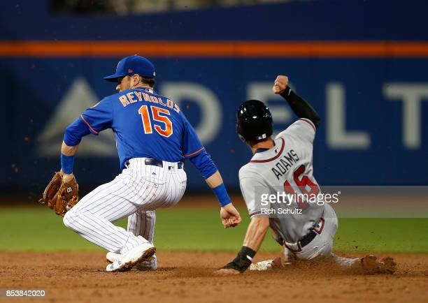 Lane Adams of the Atlanta Braves steals second base before shortstop Matt Reynolds of the New York Mets can make a tag in the during the third inning...