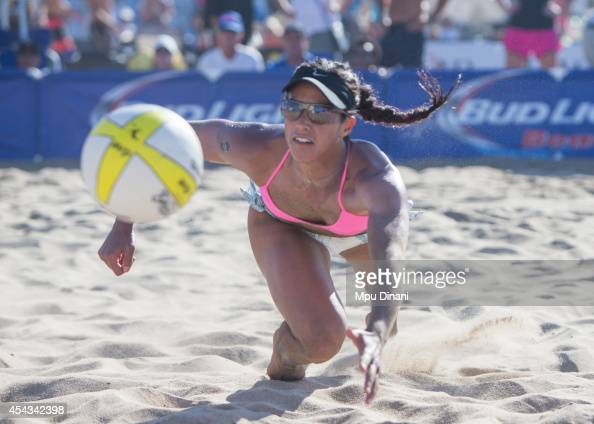 Lane Carico digs the ball during her match at the 55th AVP Manhattan Beach Open on August 17 2014 at Manhattan Beach Pier in Manhattan Beach...