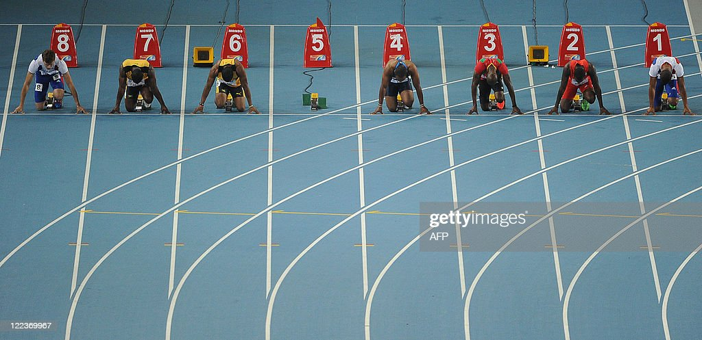 Lane five sits empty after the disqualification of Jamaica's Usain Bolt for a false start as France's Christophe Lemaitre Jamaica's Nesta Carter...