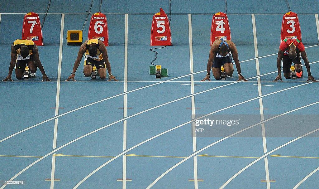 Lane five sits empty after the disqualification of Jamaica's Usain Bolt for a false start as Jamaica's Nesta Carter Jamaica's Yohan Blake US sprinter...