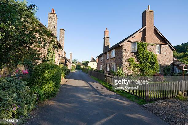 A lane leading past stone houses in the quaint and traditional village of Bossington near Porlock in Somerset.