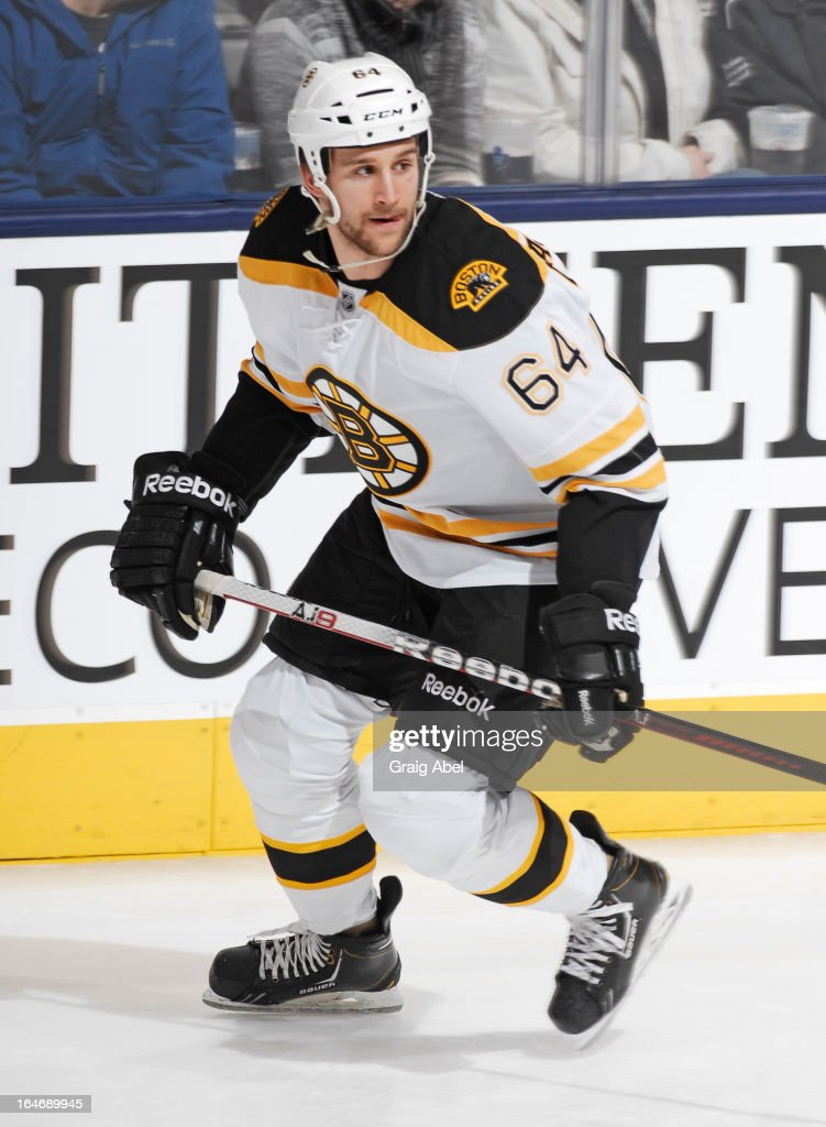 Lane MacDermid #64 of the Boston Bruins skates during warm up prior to NHL game action against the Toronto Maple Leafs March 23, 2013 at the Air Canada Centre in Toronto, Ontario, Canada.