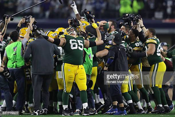 Lane Taylor of the Green Bay Packers celebrates with teammates after defeating the Dallas Cowboys in the NFC Divisional Playoff game at ATT Stadium...