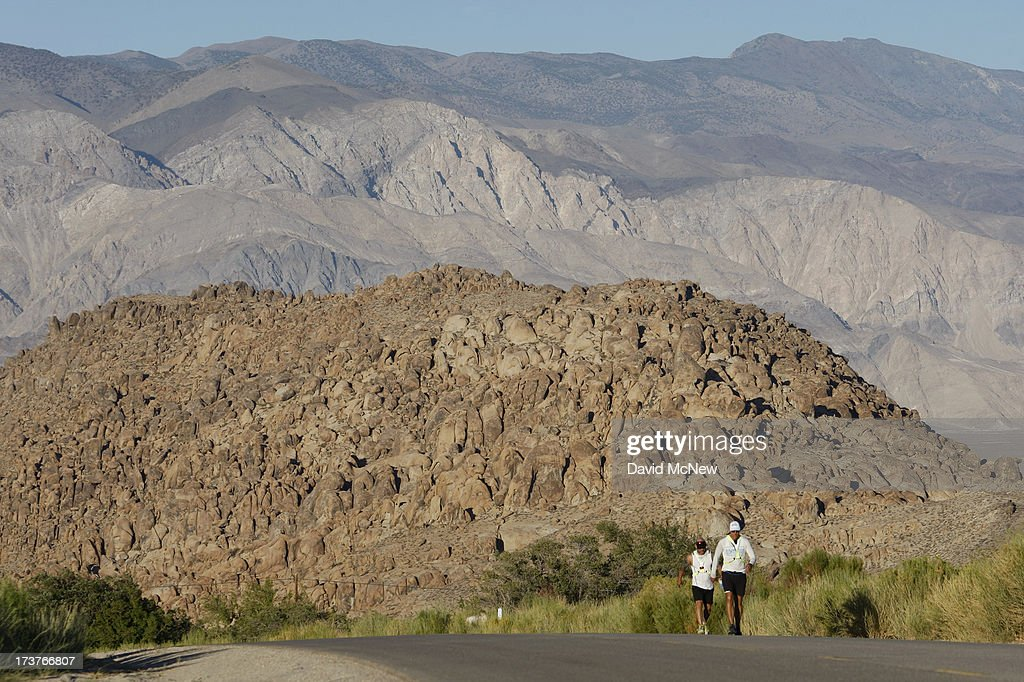 Lane Vogel (R) of Jacksonville, Florida ascends Whitney Portal Road through the Alabama Hills toward the finish of the AdventurCORPS Badwater 135 ultra-marathon race on July 16, 2013 outside of Death Valley National Park, California. Billed as the toughest footrace in the world, the 36th annual Badwater 135 starts at Badwater Basin in Death Valley, 280 feet below sea level, where athletes begin a 135-mile non-stop run over three mountain ranges in extreme mid-summer desert heat to finish at 8,350-foot near Mount Whitney for a total cumulative vertical ascent of 13,000 feet. July 10 marked the 100-year anniversary of the all-time hottest world record temperature of 134 degrees, set in Death Valley where the average high in July is 116. A total of 96 competitors from 22 nations are attempting the run which equals about five back-to-back marathons. Previous winners have completed all 135 miles in slightly less than 24 hours.