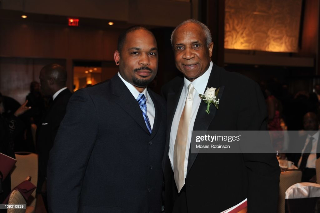 Lanero Hill and Former MLB Player and Hall of Famer Frank Robinson attend the 23rd Annual 'A Candle in the Dark' Gala at the Hyatt Regency on February 19, 2011 in Atlanta, Georgia.