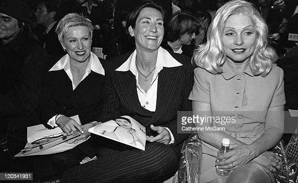 Lang Deborah Harry and unidentified at Versace Versus fashion show on March 27 1996 in New York City New York