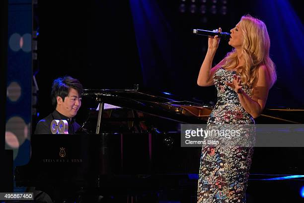 Lang Lang and host Barbara Schoeneberger are seen on stage at the GQ Men of the year Award 2015 show at Komische Oper on November 5 2015 in Berlin...