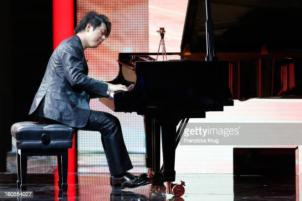 Lang Lang performs a song at 'Goldene Kamera 2013' at Axel Springer Haus on February 2 2013 in Berlin Germany
