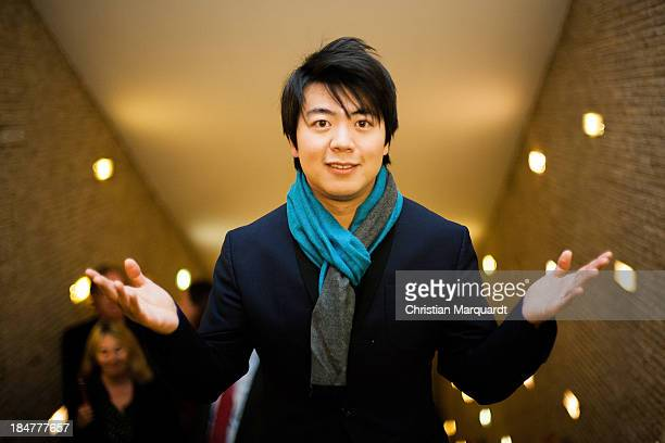 Lang Lang poses ahead of the Premiere 'The Highest Level' at Kino International on October 16 2013 in Berlin Germany