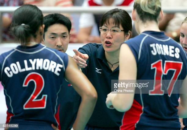 Lang Ping former coach of Chinese Women's Volleyball Team and now head coach of the United States Women's Volleyball Team instructs players during a...