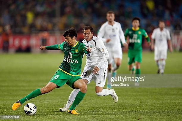 Lang Zheng of Beijing Guoan challenges Fozil Musaev of Bunyodkor during the AFC Champions League Group match between Bunyodkor and Beijing Guoan at...