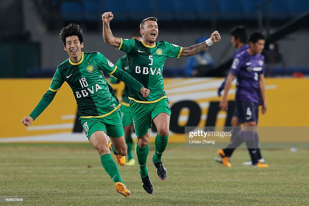 Lang Zheng (L) of Beijing Guoan with team mate Matic Darko celebrates scoring his first goal during the AFC Champions League Group match between Hiroshima Sanfrecce and Beijing Guoan at Beijing Workers' Stadium on March 13, 2013 in Beijing, China.