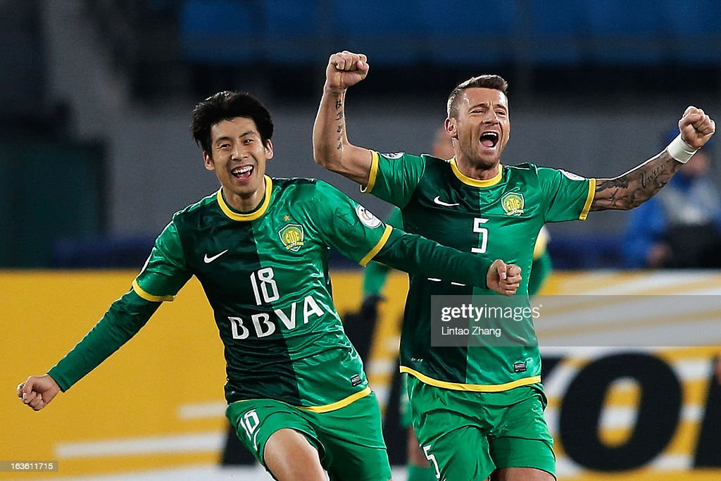 Lang Zheng (L) of Beijing Guoan with teammate Darko Matic celebrates scoring his first goal during the AFC Champions League Group match between Hiroshima Sanfrecce and Beijing Guoan at Beijing Workers' Stadium on March 13, 2013 in Beijing, China.